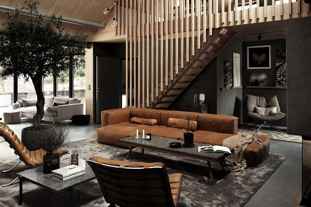 decoración de un loft tipo industrial con muebles vintage de cuero