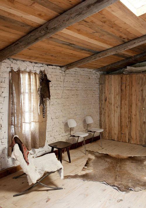 Cálidos textiles en la decoración de casas rurales
