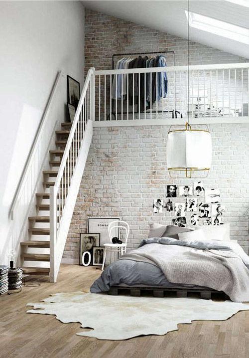 dormitorio decorado con un estilo nórdico industrial