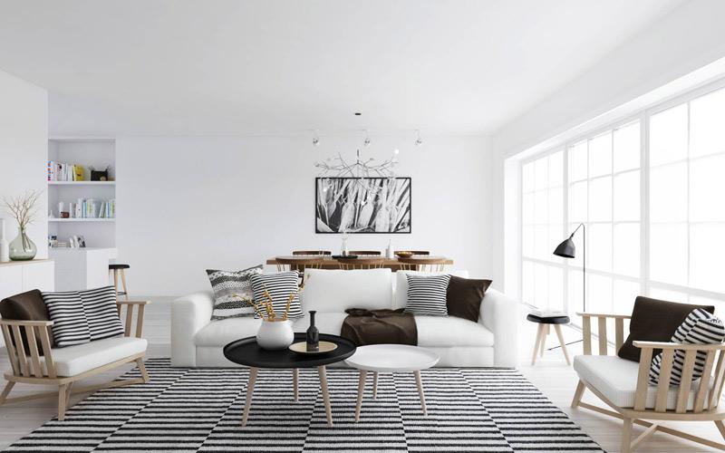 Salón nórdico con alfombra de figuras geométricas