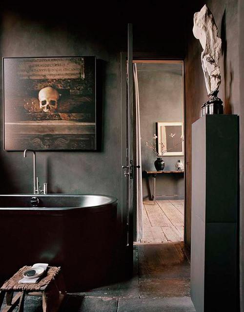 Lavabo decorado con tonos oscuros