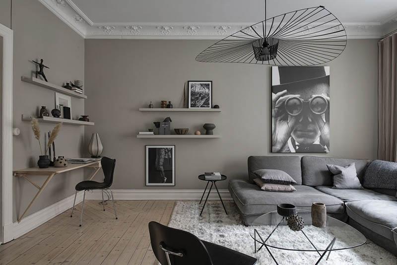 Tonos de color gris en las paredes de un salón de estilo nórdico