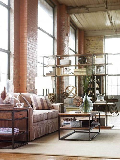 Estanterías para dividir los espacios en una vivienda tipo loft industrial