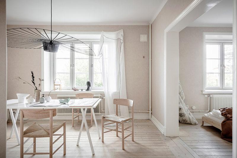 salón comedor en un apartamento de estilo nórdico