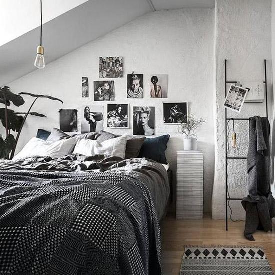 decoración de la pared de un dormitorio de estilo nórdico con fotografías