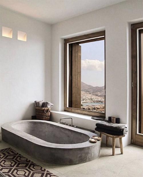 bañera de hormigón en un baño de estilo minimalista