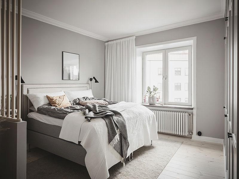 apliques de pared de color negro para iluminar y decorar un dormitorio de estilo nórdico