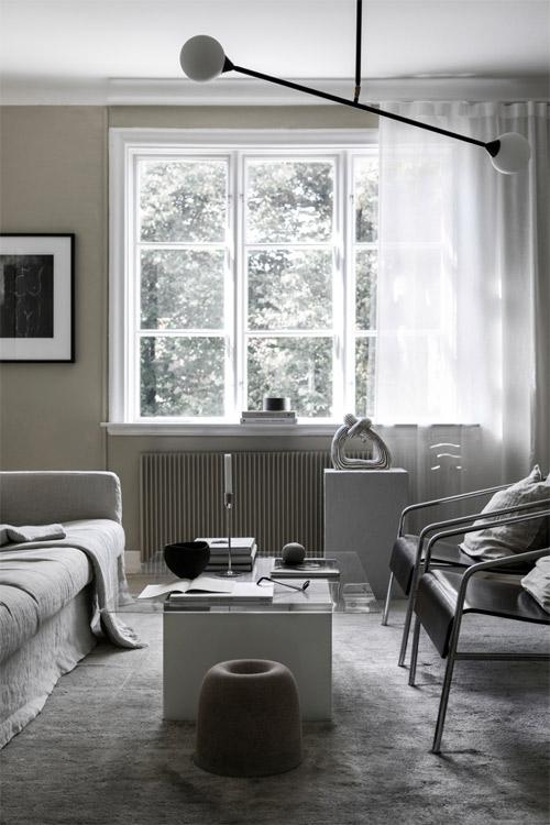 Sala de estar decorada en tonos grises
