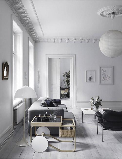 Salón de estilo nórdico en tonos de color blanco, negro y gris