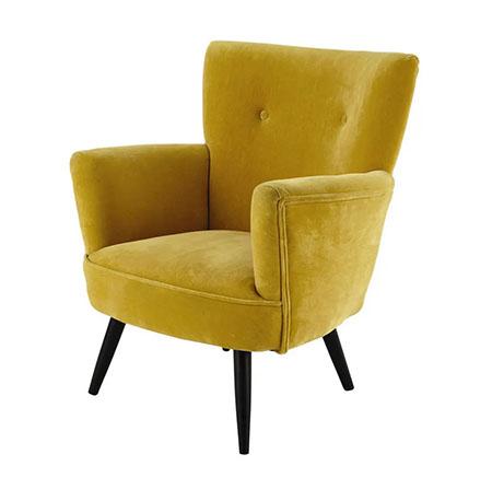 sillón de terciopelo de tela de color amarillo mostaza