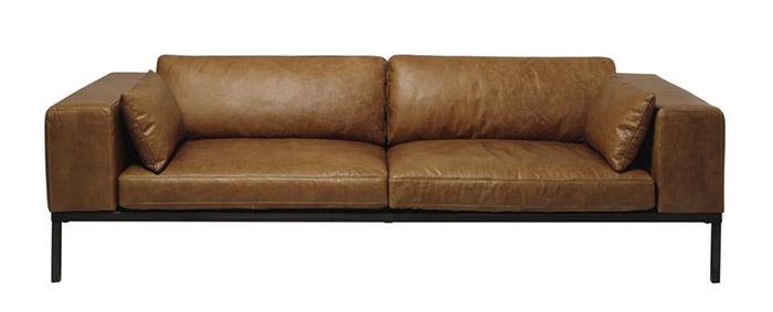 sofá de piel envejecida para la decoración del salon