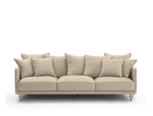 sofa beige cojines