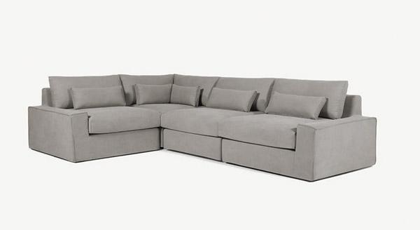 sofá esquinero de 4 plazas de tela gris